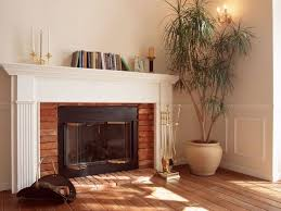 fireplace design plan featuring brick tiles and white mantels