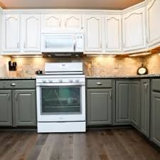 dark hardwood floor for traditional kitchen design and two tone kitchen cabinets with under cabinet lighting cabinet lighting backsplash home design