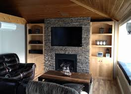 wall with stone veneer panels plus tv and fireplace and sofa set for family room ideas