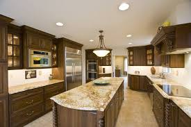 modern rustic kitchen with granite counter top wooden cabinets chandelier