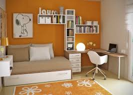 orange and white chic home office with small daybed and under bed storage chic home office white
