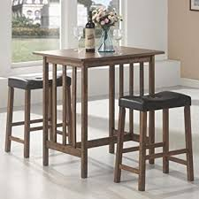 table with stools. 3pc breakfast table and stools set in nut brown with a