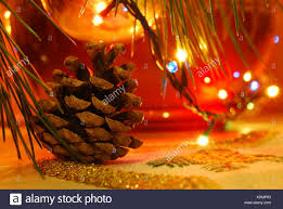 Close Up Of A Pine Cone And Christmas Lights Stock Photo