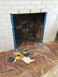 ready to paint the newly cleaned fireplace firebox thediybungalow com