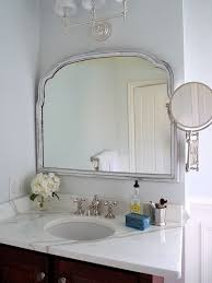 Amazing bathroom with Restoration Hardware Wilshire Triple Sconce accents  silver leaf mirror over calcutta gold marble top vanity with Restoration  Hardware ...