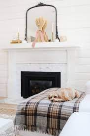 fall mantel decorated with antiques and