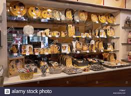 a tourist oriented at the vienna market in austria selling gustav klimt gifts including plates mugs and other tchotchkes
