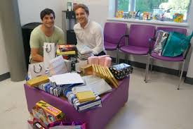adam left and mark broude who handed out gifts to age cancer patients in memory of their brother robert