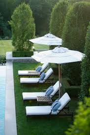 image outdoor furniture chaise. Home Exterior ~ Pool Chaise Lounge Umbrellas Landscaping Luxury Image Outdoor Furniture