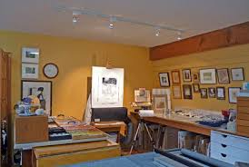 painting studio lighting. this photo shows my new painting area with the track lighting has pastels on drafting table to left of easel and studio c
