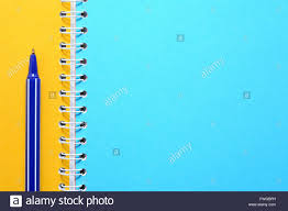 Stationery Background Blue Pen On Notebook With Colored Blank Pages
