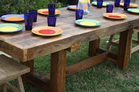 custom diy solid wood outdoor farmhouse kitchen table with wood folding chairs on green grass in the backyard garden house design ideas