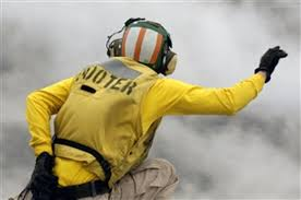 Lt. Dustin Hendrix signals through the steam for the catapult ...