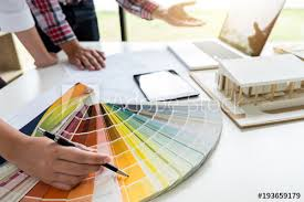 Interior Design Colour Chart Two Young Women Interior Design Or Graphic Designer Working