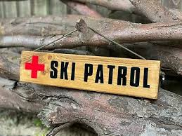 wooden ski patrol wall coat rack hooks