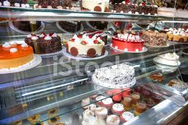 Cakes For Sale In Refrigerated Display Cabinet Stock Photos