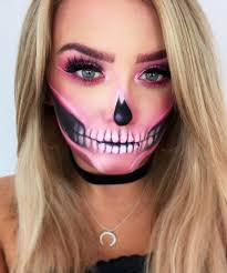 bright bones the use of neon pink gives a modern feel to this half skeleton makeup look the eyes are all glam with a pink smoky eye