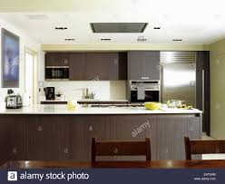 eat in kitchen furniture. Dining Table And Chairs In Front Of Central Island Unit Spacious Kitchen With Wood Units Eat Furniture K