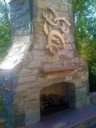 bronze wall sculpture over outdoor fireplace california metal wall artmetal