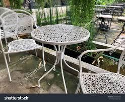 Zen garden furniture Magical Outdoor Furniture White Steel Chairs And Table In The Zen Garden Landscape Danielsantosjrcom Outdoor Furniture White Steel Chairs Table Stock Photo edit Now