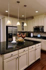 dark countertops with cream cabinets