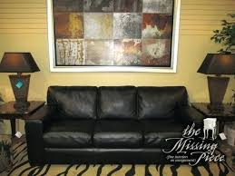 contemporary style sofa in a black bonded leather on block feet simple clean lines great for