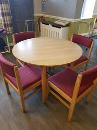 4 round dining tables and 12 chairs job lot