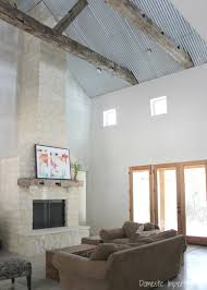 corrugated metal ceiling rustic beams and stone