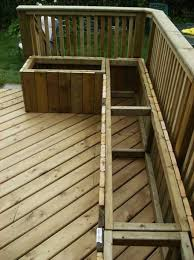 how to build a wooden deck over a concrete one with storage bench outdoor storage