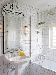 image by peach studio image by peach studio mirrored subway tile bathroom