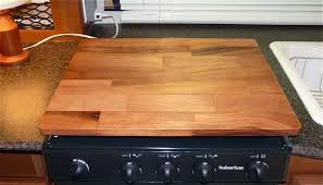 that offers a generous amount of counter space but we still prefer to use a stove top hardwood cutting board and haven t missed the sink covers at all