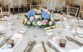 a vintage style round top table arrangement for the wedding breakfast
