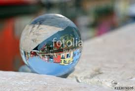 large glass sphere with the image of the colorful houses of the