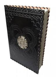 leather black note book medallion the hippie house