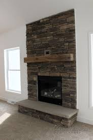 Fireplace Refacing Cost We Just Cant Get Enough Of This Custom Cultured Stone Fireplace