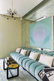 designer blue sofa and cushions by kelly wearstler