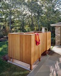 classic unfinished pine wood outside shower enclosure for country backyard landscaping with stacked stones houses and stones floors ideas
