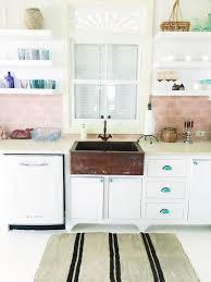 scandanavian kitchen retro kitchen pink backsplash copper sink