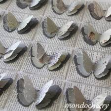 3 d erflies on old book pages or newspaper print i think they used fabric but i would opt for paper love this for paper and fabric crafts