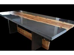 polished concrete furniture. polished concrete with addition of wood slabs for table or counter top furniture o