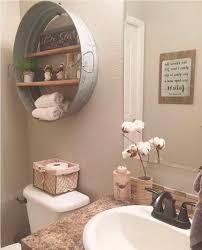 bathroom wall decorating ideas. Beige Wall Color With Antique Decor For Elegant Bathroom Decorating Ideas Nice Frameless Mirror O