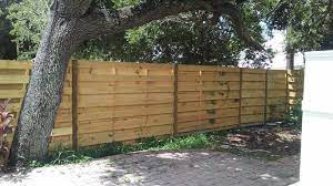 The total cost varies based on materials, size, design, and labor expenses. Wood Fences Usa Fence Florida S Fence Contractor
