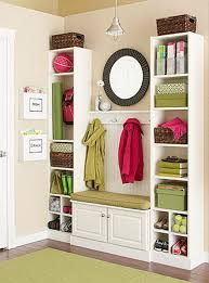 create this mini mudroom from ikea billy bookcases and a bit of beadboard and trim