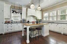 white country kitchen designs. Simple White Country Kitchen With White Shaker Cabinets Butcher Block Island And Black  Granite Countertops Throughout White Kitchen Designs H