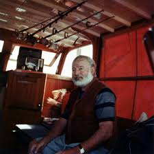 the old man and the sea by ernest hemingway writework american author ernest hemingway aboard his yacht around 1950