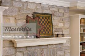 fireplace detail of suspened mantel on a stone fireplace crown molding game boards