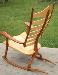 wooden rocking chair. pricing: wooden rocking chair d