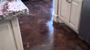 acid stained look decorative concrete overlay replaces ceramic tile in executive home s kitchen you