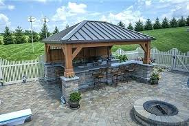 covered outdoor kitchen patio and bar with fireplace cost plans k