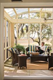 Covered porch furniture Elegant Front Sunny Screened Porch One Kings Lane Porch And Patio Design Inspiration Southern Living